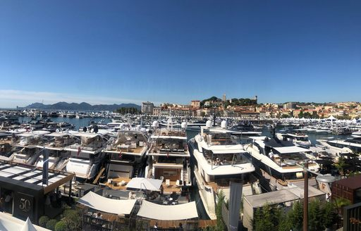 Aft decks of yachts lined up at cannes yachting festival
