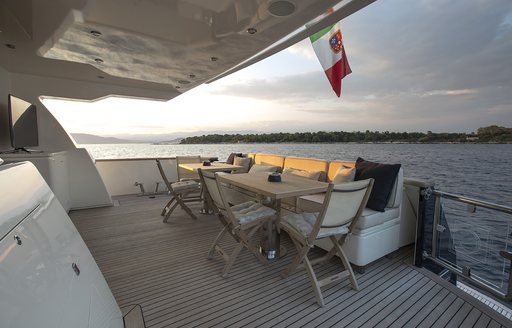 alfresco dining on aft deck of charter yacht cappuccino