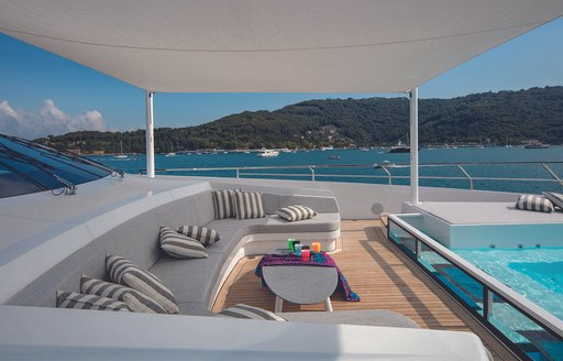 Pool and seating area on luxury yacht MA, with sofas and shaded area