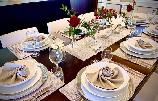 Close up of laid dining table on superyacht LIONSHARE