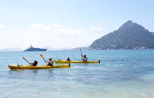 kayaking in the mediterranean, with amels yacht spirit in background