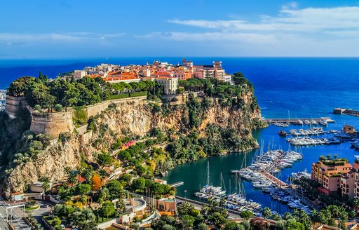 views over the old town of monaco, with sea below