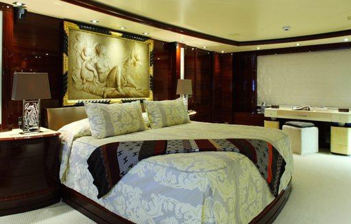 Luxury yacht VERTIGO main cabin, with statues on wall