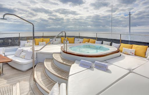 Spa pool on sundeck of luxury yacht Baron Trenck, with sunpads surrounding and shower