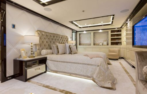 opulent master suite with white furnishings on board motor yacht ELIXIR