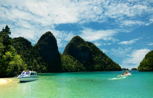 A smaller yacht and tender in Raja Ampat