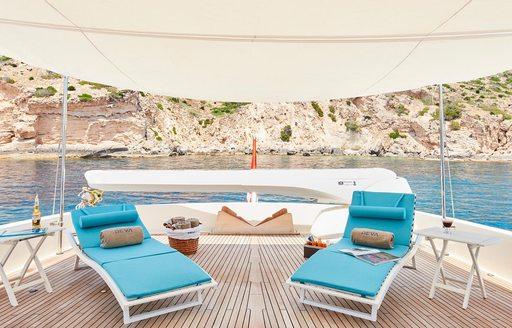 sun loungers under a canopy on board luxury yacht DEVA