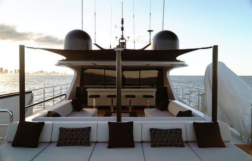 bar, sofa and sunning station on the flybridge of motor yacht SAHANA