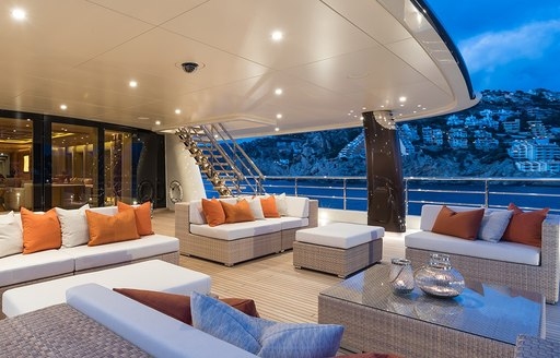 Al fresco dining and seating area on board luxury yacht Here Comes the Sun