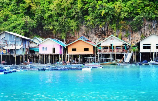 houses on stilts in a fishing village in Thailand waters