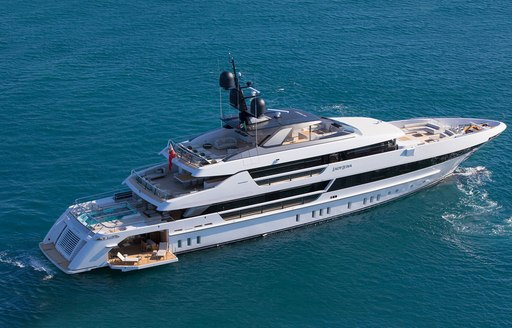 aerial shot of Lady Lena by sanlorenzo providing a view of her main deck swimming pool, extendable side deck which open up to her beach club, upper alfresco dining area, capacious forward deck, nd spacious sun deck