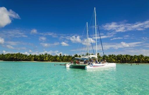 Catamaran on azure shores of the Bahamas