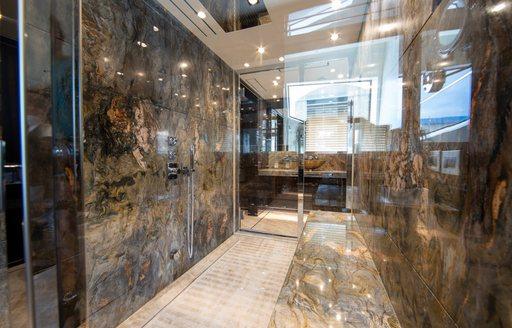 marble walls in the en suite of benetti luxury yacht happy me