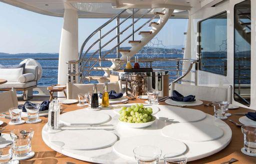 Aft dining area onboard MY Kamalaya
