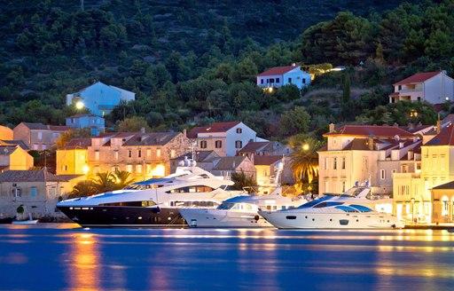 Yachts moored at night in Croatia