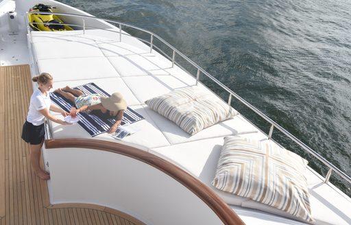 Sun pad lounging area aboard luxury yacht REBEL