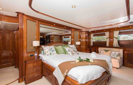 master suite with large bed at its centre aboard motor yacht DXB