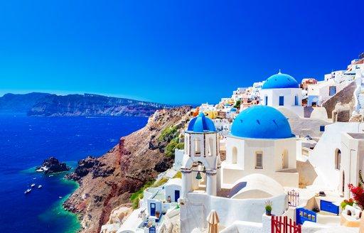 Stunning town of Oia in Santorini overlooking blue waters