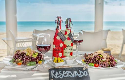 outdoor dining table at Ponderosa Beach in Mallorca, the Balearics