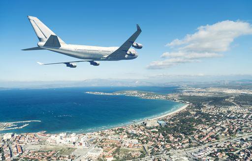 aeroplane flying over coastlines of greece