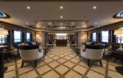 The grid carpet and seating featured inside of superyacht 'Mine Games'