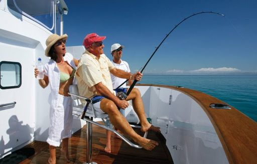 charter guests enjoy game fishing on board luxury yacht 'Emerald Lady'