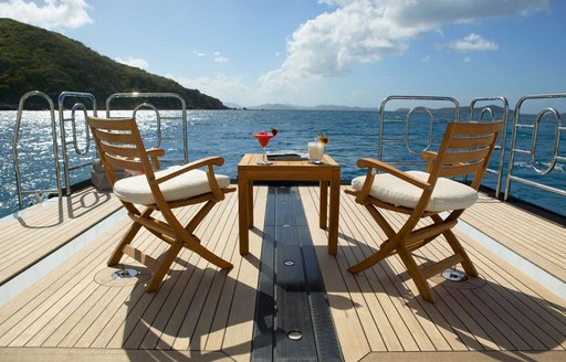 swim platform with small table and chairs on board luxury yacht HARLE