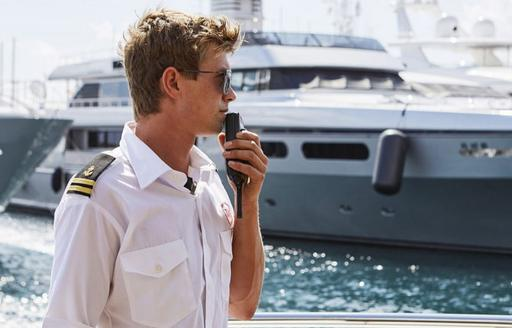 Below deck chief Bosun on the radio during docking of yacht