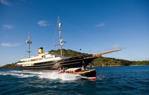 classic yacht NERO cruises on a luxury yacht charter alongside classic style tender