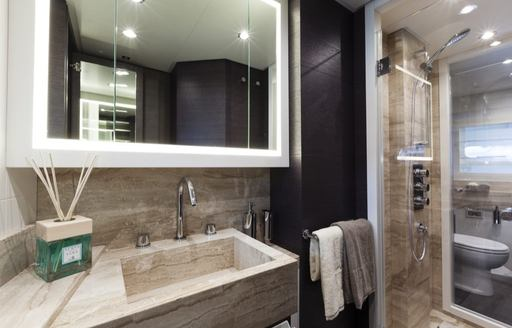 Elegant marble bathroom on superyacht 55 FIFTYFIVE