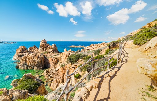 a rocky path on the coast of a popular yacht charter destination sardinia