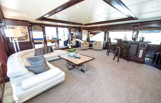 Main salon with L-shaped sofa and skylight aboard luxury yacht REBEL