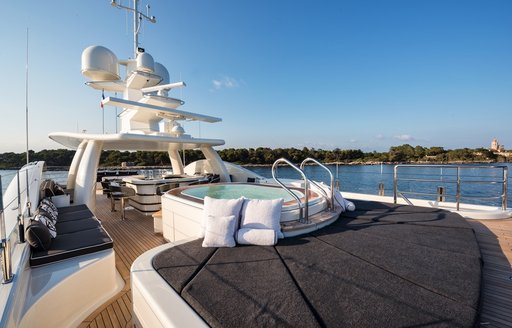 sun pads and Jacuzzi on the sundeck aboard charter yacht ELIXIR