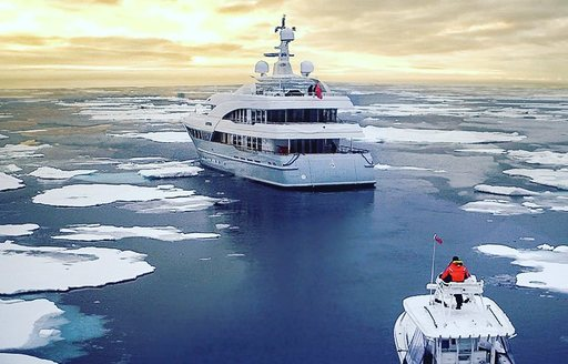 Superyacht LATITUDE underway as she cruise through the arctic surrounded by ice