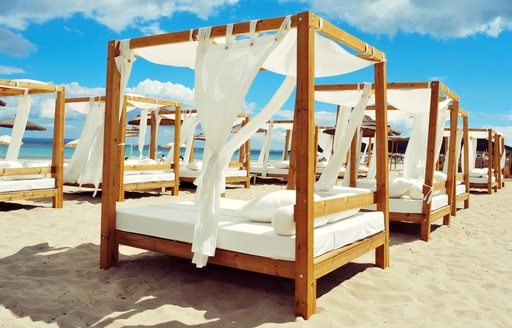 White sunbed in the sand on the island of Ibiza