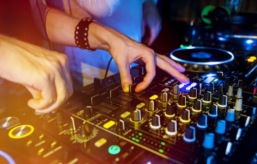 DJ works the decks at a superyacht party