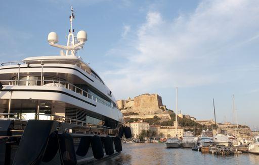 superyacht lined up in Bonifacio harbour facing citadel