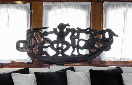 interior detail of statue on luxury charter yacht over the rainbow