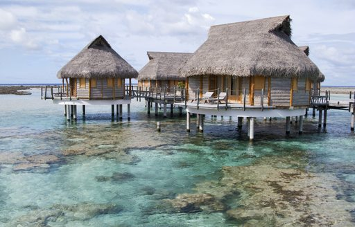 Overwater bungalows in the South Pacifc islands