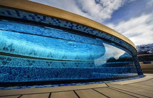 Glass-edge swimming pool on superyacht Flying Fox
