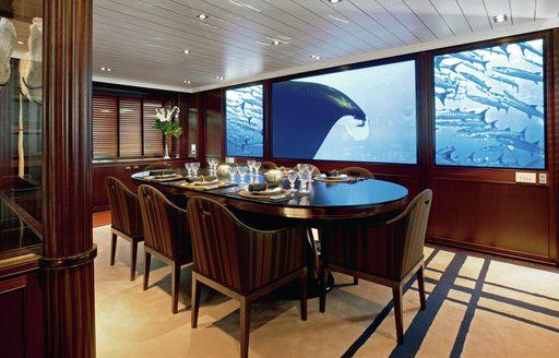 dining set-up on interior of motor yacht galileo g