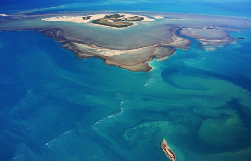 aerial view of Montgomery Reef with blue seas in Australia
