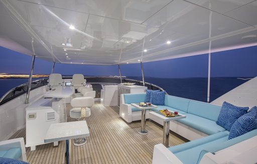 chic flybridge with comfortable lounge and helm on board charter yacht 'Lady Carmen'