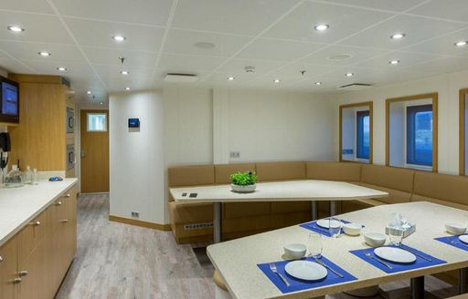 Interior of Game Changer yacht with laid out dining surface
