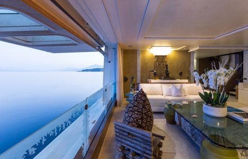 side balcony in main salon aboard Lurssen charter yacht Coral Ocean