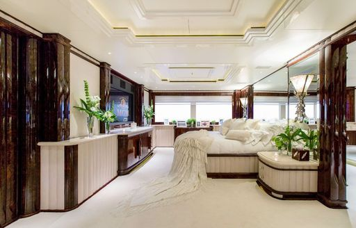 Master cabin onboard Charter yacht 'Lioness V', central berth on starboard side facing flat screen TV, surrounded by windows