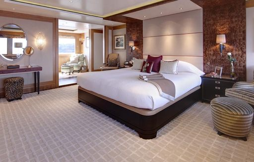 Master cabin onboard Charter Yacht 'Lady Britt', central berth with adjacent night stands and dressing table in background