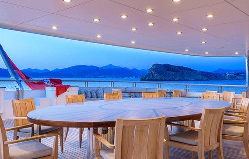 alfresco dining area on the upper deck aft of motor yacht BOADICEA