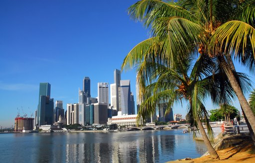 high rise buildings look over waters in Singapore