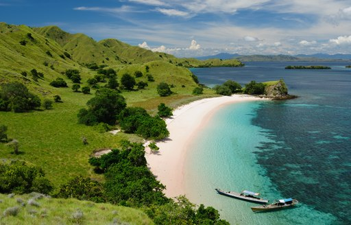 beach in papua new guinea with green backdrop